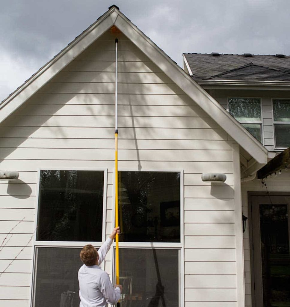 An exterminator is doing wasp nest removal at a home in Vancouver, WA.