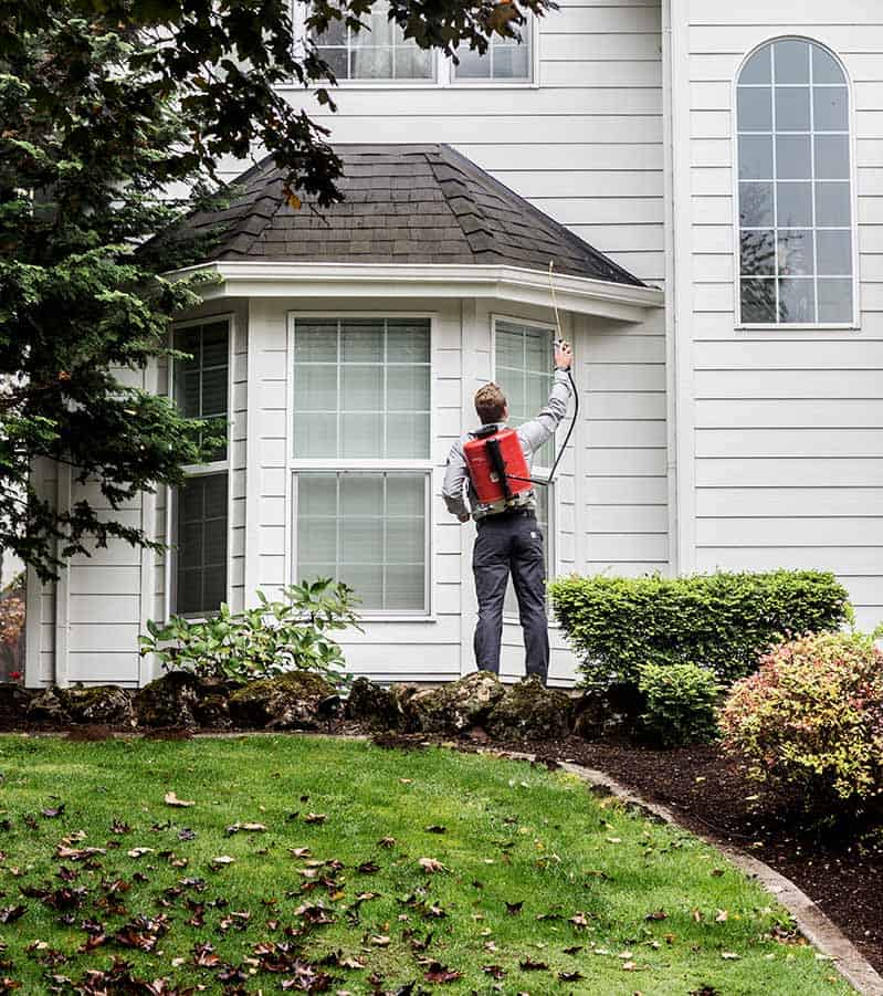 Aspen Pest Control Technician Treating a Vancouver WA Yard with Green Pest Control Product